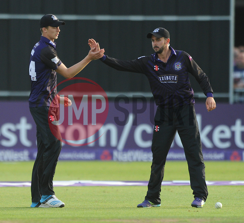 Craig Miles of Gloucestershire celebrates catching out Tom Cooper of Somerset for 14 with Jack Taylor of Gloucestershire - Photo mandatory by-line: Dougie Allward/JMP - Mobile: 07966 386802 - 19/06/2015 - SPORT - Cricket - Bristol - County Ground - Gloucestershire v Somerset - Natwest T20 Blast