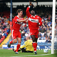 Photo: Back Page Images. 16/10/2004.<br /> Barclays Premiership. Blackburn Rovers v Middlesbrough. Ewood Park.<br /> Jimmy Floyd Hasselbaink salutes the almighty after his second goal as Chris Riggot joins him