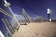 Solar energy electrical generating power plant in the Mojave Desert near Barstow, California. Solar One consists of a circular arrangement of 1, 818 mirrors, each measuring 23x23 feet (7x7 meters). These mirrors focus the sunlight onto a huge central receiver, which sits atop a 300-foot (91 meter) tower. The mirrors are computer controlled to track the path of the sun. Water is pumped through the receiver and heated to a temperature of 960 degrees Fahrenheit. The resultant steam runs a turbine, producing 10 megawatts of power for eight hours a day. (1982).