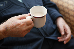 Close up of hands holding a cup of tea,