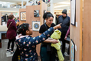 Town of Wallkill, New York - People look at art from the 2018 All-County Musical Showcase and Visual Arts Display at the Galleria at Crystal Run on Feb. 24, 2018.