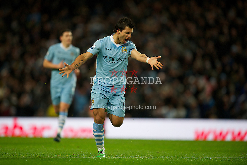 MANCHESTER, ENGLAND - Tuesday, January 3, 2012: Manchester City's Sergio Aguero celebrates scoring the first goal against Liverpool during the Premiership match at the City of Manchester Stadium. (Pic by David Rawcliffe/Propaganda)