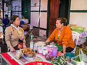11 MARCH 2013 - LUANG PRABANG, LAOS: Women chat in the market in Luang Prabang, Laos.     PHOTO BY JACK KURTZ