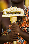 A man holds a golden staff shaped as a crab during the annual Oguaa Fetu Afahye Festival in Cape Coast, Ghana on Saturday September 6, 2008.