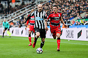 Jonjo Shelvey (#8) of Newcastle United drives forward with the ball pursued by Jonathan Hogg (#6) of Huddersfield Town during the Premier League match between Newcastle United and Huddersfield Town at St. James's Park, Newcastle, England on 31 March 2018. Picture by Craig Doyle.