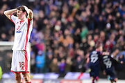 Milton Keynes Dons midfielder Conor McGrandles (18) holds his head in his hands as The Portsmouth players celebrate their winning goal during the EFL Sky Bet League 1 match between Milton Keynes Dons and Portsmouth at stadium:mk, Milton Keynes, England on 10 February 2018. Picture by Dennis Goodwin.