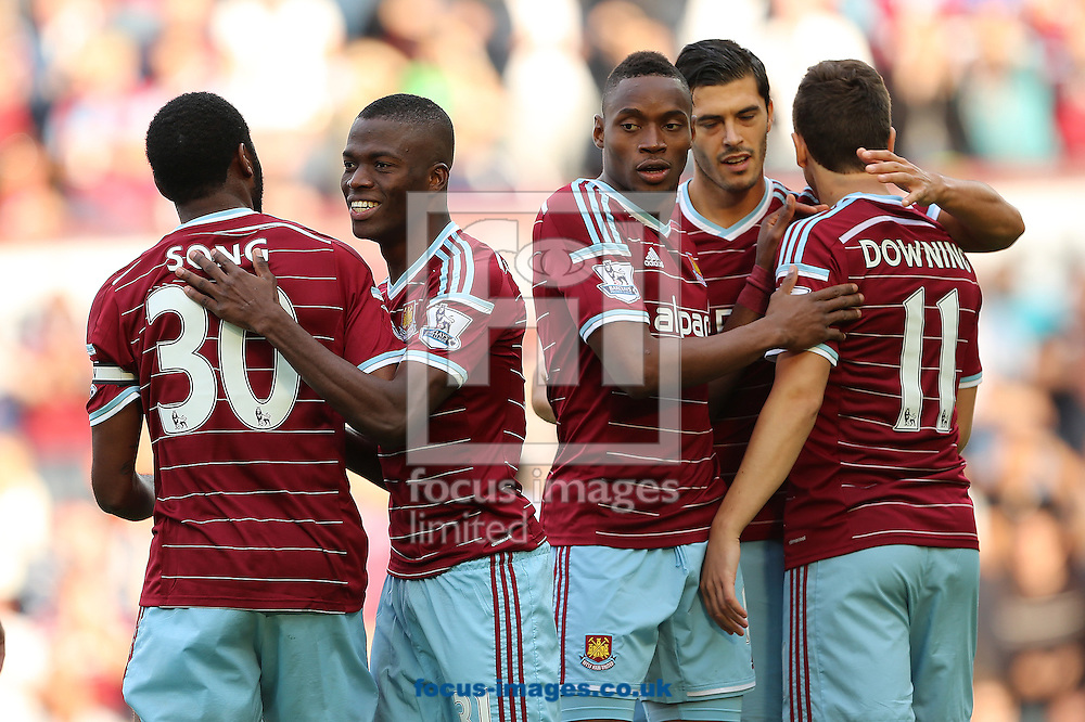 Diafra Sakho (right centre) celebrates amongst team mates after scoring the opening goal of the Barclays Premier League match against Queens Park Rangers at the Boleyn Ground, London<br /> Picture by Richard Calver/Focus Images Ltd +447792 981244<br /> 05/10/2014