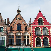 Distinctive houses in the Markt (Market Square) in the historic center of Bruges, a UNESCO World Heritage site.