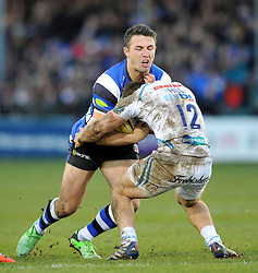 Sam Burgess of Bath Rugby is tackled by Sam Hill of Exeter Chiefs - Photo mandatory by-line: Patrick Khachfe/JMP - Mobile: 07966 386802 27/12/2014 - SPORT - RUGBY UNION - Bath - Recreation Ground - Bath Rugby v Exeter Chiefs - Aviva Premiership