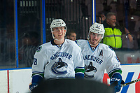 PENTICTON, CANADA - SEPTEMBER 8: Zack MacEwan #64 and Kole Lind #78 of Vancouver Canucks celebrate a goal  against the Winnipeg Jets on September 8, 2017 at the South Okanagan Event Centre in Penticton, British Columbia, Canada.  (Photo by Marissa Baecker/Shoot the Breeze)  *** Local Caption ***