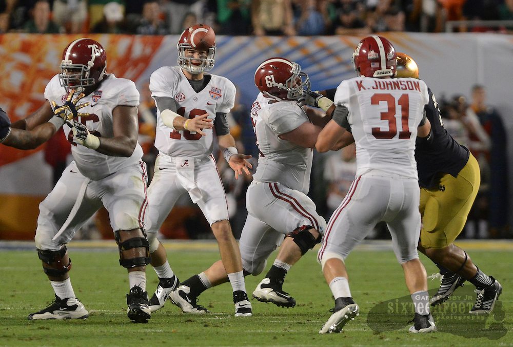 Daily Photo by Gary Cosby Jr.   Alabama quarterback AJ McCarron (10) dumps a short pass off to Alabama tight end Kelly Johnson (31) during the second half of the BCS National Championship Game in Sun Life Stadium Monday, January 7, 2013.