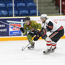 TRENTON, ON  - MAY 4,  2017: Canadian Junior Hockey League, Central Canadian Jr. &quot;A&quot; Championship. The Dudley Hewitt Cup. Game 5 between Powassan Voodoos and the Georgetown Raiders.  Shane Beaulieu #7 of the Powassan Voodoos and Griffin James #4 of the Georgetown Raiders skates after the puck during the second period.<br /> (Photo by Tim Bates / OJHL Images)