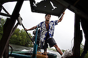 PHANG NGA PROVINCE,SOUTHERN THAILAND,AUGUST 2012: Ngui, a moken fisherman, driving his boat out of the canal and into the sea.<br /> The Moken are a nomadic sea people who live in and around southern Thailand, traditionally feeding of the fruits of the sea for eight months a year. But the 2004 Indian Ocean tsunami destroyed many livelihoods, and the Moken were forced onto the land.<br /> Brought to the world's attention by the natural disaster, the seafaring tribe is struggling to reconcile tradition and modernity, leaving behind their &quot;sea gypsy&quot; life for a modern existence