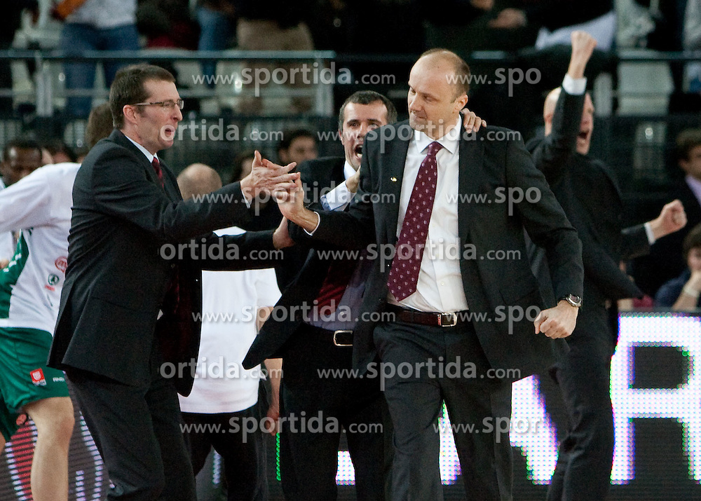 Jaka Daneu, Miro Alilovic and Head coach of Olimpija Jure Zdovc celebrate after the Euroleague Top 16 basketball match between Lottomatica Virtus Roma (ITA) and KK Union Olimpija Ljubljana (SLO) in Group F, on January 20, 2011 in Arena PalaLottomatica, Rome, Italy. Olimpija defeated Lottomatica 64 - 63. (Photo By Vid Ponikvar / Sportida.com)