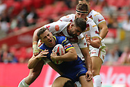 Mickael Simon of Catalans Dragons tackles Toby King of Warrington Wolves  around the head during the Ladbrokes Challenge Cup Final match at Wembley Stadium, London<br /> Picture by Stephen Gaunt/Focus Images Ltd +447904 833202<br /> 25/08/2018