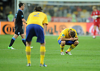 Football - European Championships 2012 - Sweden vs. England<br /> Anders Svensson of Sweden looks dejected following his teams loss at the Olympic Stadium, Kiev, Ukraine