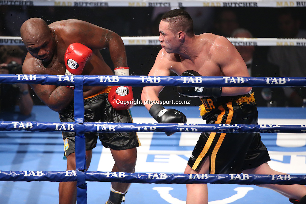 Joseph Parker, right fights Sherman Williams at the Heavyweight Explosion between Joseph Parker and Sherman Williams at Trusts Arena, Henderson, Auckland on Thursday, October 16, 2014.  Photo: Fiona Goodall/photosport.co.nz