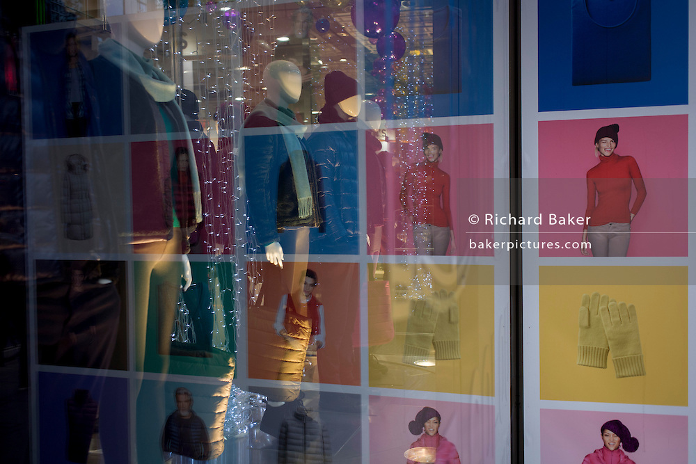 Fashions and styles in H&M retailer's window on London's Oxford Street.