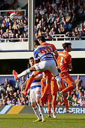 QPR's forward Modibo Maiga and Blackpool's defender Craig Cathcart compete for the ball - Photo mandatory by-line: Mitchell Gunn/JMP - Tel: Mobile: 07966 386802 29/03/2014 - SPORT - FOOTBALL - Loftus Road - London - Queens Park Rangers v Blackpool - Championship