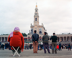 Pilgrims to the Madonna of Fatima listen to a sermon in the square at the Roman Catholic Cathedral of Fatima in Portugal.