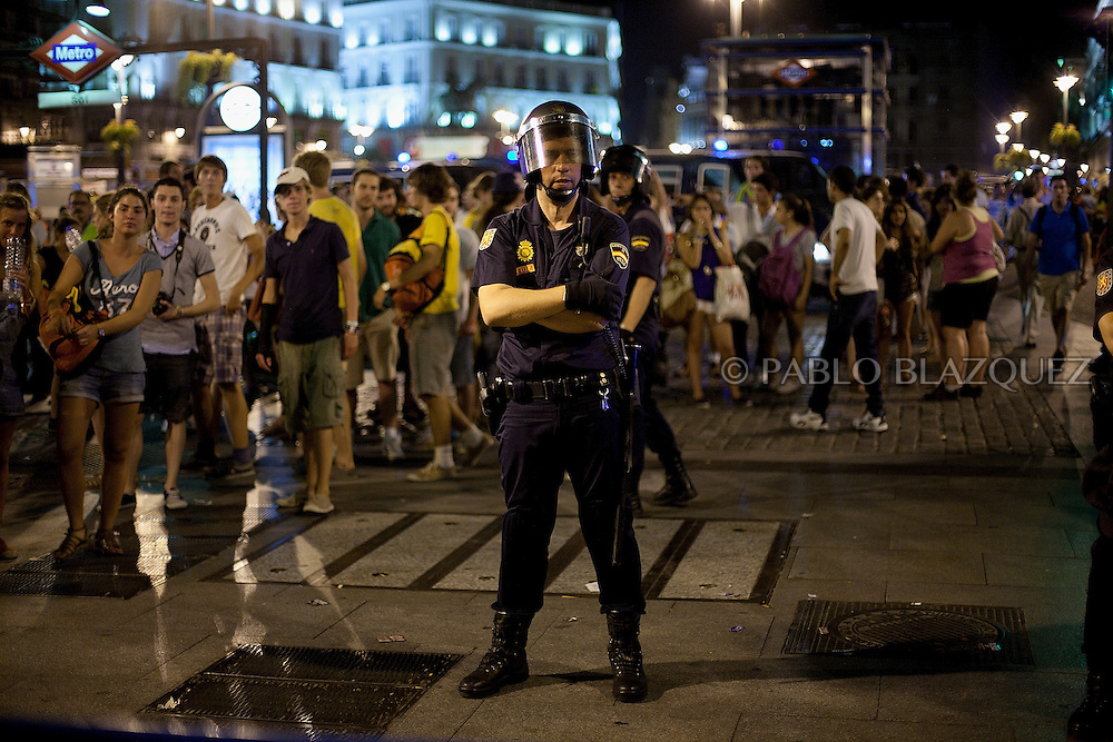 Police prevent protesters enter Puerta del Sol Square during a march in central Madrid late August 19, 2011 against a visit by Pope Benedict XVI and police violence during previous demonstrations, after the pontiff presided over a service a few hundred metres away. The activists were angry over the cost of the World Youth Day celebrations led by the pope, and over police crackdowns on their previous demonstrations.