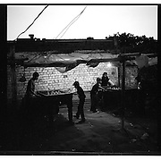 "Young Christian boys play table football at a makeshift recreation in a Christian colony in Islamabad. Christians, Ahmadis and the Shia community have been at the forefront of sectarian attacks in Pakistan in the last two decades, accounting for more than 4000 sectarian deaths...A 2005 International Crisis Group report concluded ""sectarian conflict in Pakistan is the direct consequence of state policies of Islamisation and marginalisation of secular democratic forces"".  Sectarianism and other forms of intolerance have gone well beyond the political realm, and are now becoming  a social norm in Pakistan...A January 2010 report by the Legatum Institute, a London-based think tank, argues that Pakistani society will become more Islamist in the coming years."
