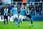 Jonjo Shelvey (#8) of Newcastle United steps in to win the ball from Kevin De Bruyne (#17) of Manchester City during the Premier League match between Newcastle United and Manchester City at St. James's Park, Newcastle, England on 30 November 2019.