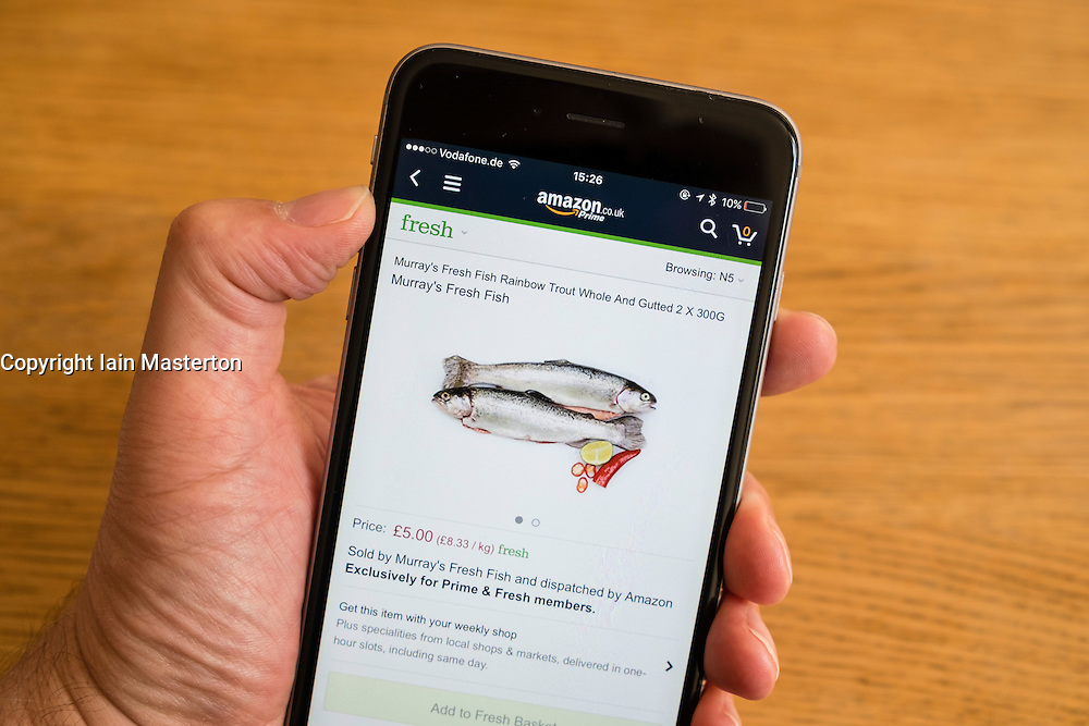 Amazon Prime Fresh food delivery service app shown on an iPhone 6 smart phone
