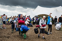 Festivalgoers arriving with their camping equipment at the Brownstock Festival in Essex.