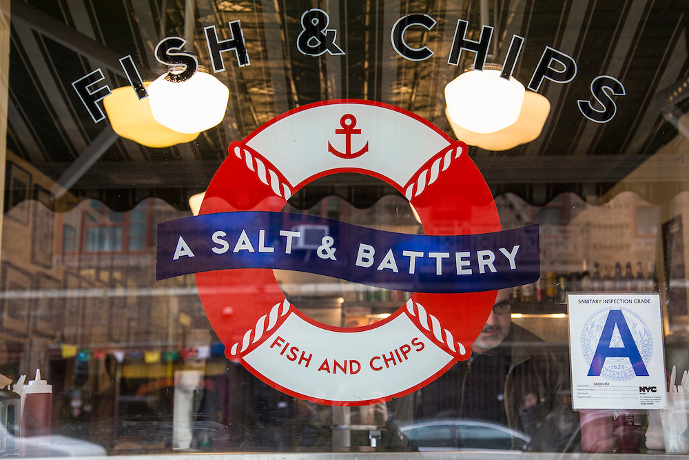 A Salt & Battery shop window sign on 112 Greenwich Avenue, New York City,  New York, United States of America.  The cafe restaurant serves traditional British Fish and Chips.  (photo by Andrew Aitchison / In pictures via Getty Images)