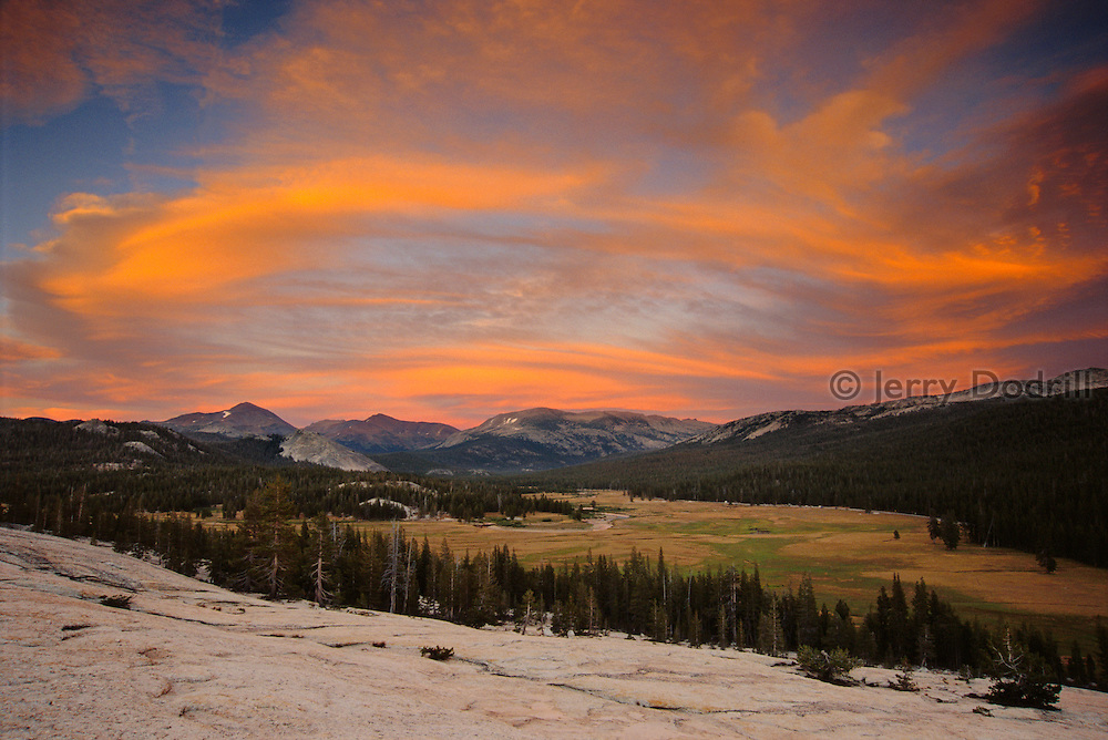 The Sierra Wave, lenticular clouds, at sunset over Tuolumne Meadows from Pothole Dome in Yosemite National Park, California