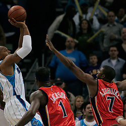 30 January 2009:  New Orleans Hornets forward David West (30) shoots over Golden State Warriors defenders Kelenna Azubuike (7) and Stephen Jackson (1) during a 91-87 loss by the New Orleans Hornets to Golden State Warriors at the New Orleans Arena in New Orleans, LA.
