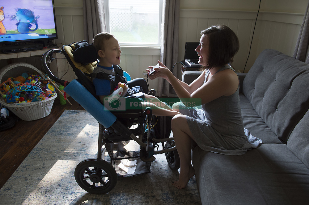 August 6, 2017 - Marietta, GA - SARAH ALLEN is both single mother and full-time -- though untrained --nurse to her son Aidan, born with cerebral palsy and complex medical issues.  State Medicaid regulations severely limit the number of hours her medically fragile son can have in-home nursing care, regardless of his doctor's orders for medical necessity. Aidan needs 24-7 care and constant tube feeding. Sarah may soon be homeless because the house where she lives will be sold, and she has limited resources to find another home suitable for a severely disabled child.  Her story illustrates several serious shortfalls within the Medicaid and Social Security Disability systems. PICTURED: Sarah entertains her son with a video clip from the television series 'Law and Order.''  Aidan finds the opening theme fun and laughs every time he hears it. (Credit Image: © Robin Rayne Nelson via ZUMA Wire)