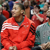 17 March 2012: Chicago Bulls point guard Derrick Rose (1) and Chicago Bulls forward Taj Gibson (22) are seen smiling on the bench during the last seconds of Chicago Bulls 89-80 victory over the Philadelphia Sixers at the United Center, Chicago, Illinois, USA.