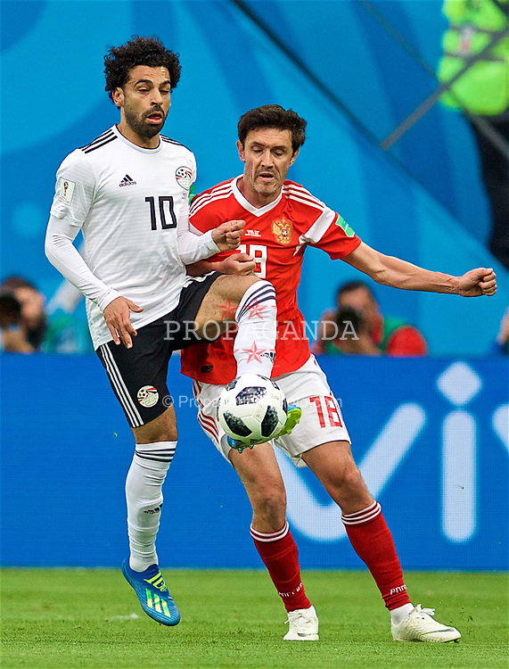 SAINT PETERSBURG, RUSSIA - Tuesday, June 19, 2018: Egypt's Mohamed Salah and Russia's Yury Zhirkov during the FIFA World Cup Russia 2018 Group A match between Russia and Egypt at the Saint Petersburg Stadium. (Pic by David Rawcliffe/Propaganda)