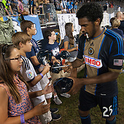 Philadelphia Union Defender Sheanon Williams (25) signs autograph for a fan after a MLS regular season match against the Portland Timbers Saturday, July. 20, 2013 at PPL Park in Chester PA.