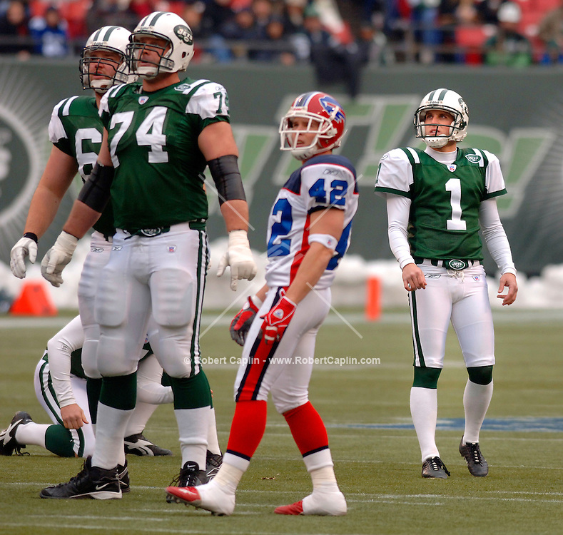 New York Jets' kicker, Mike Nugent watches his field-goal sail through the uprights in the second quarter during the New York Jets vs. Buffalo Bills Match-up at Giants Stadium Sunday, 1/1/06. The Jets won the game 30-26. Photo Credit: Robert Caplin for The New York Times....
