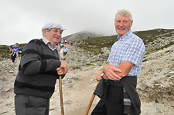 Francis Leneghan and Anthony Flaherty from Gort Co Galway pictured on Croagh Patrick yesterday.<br /> Pic Conor McKeown