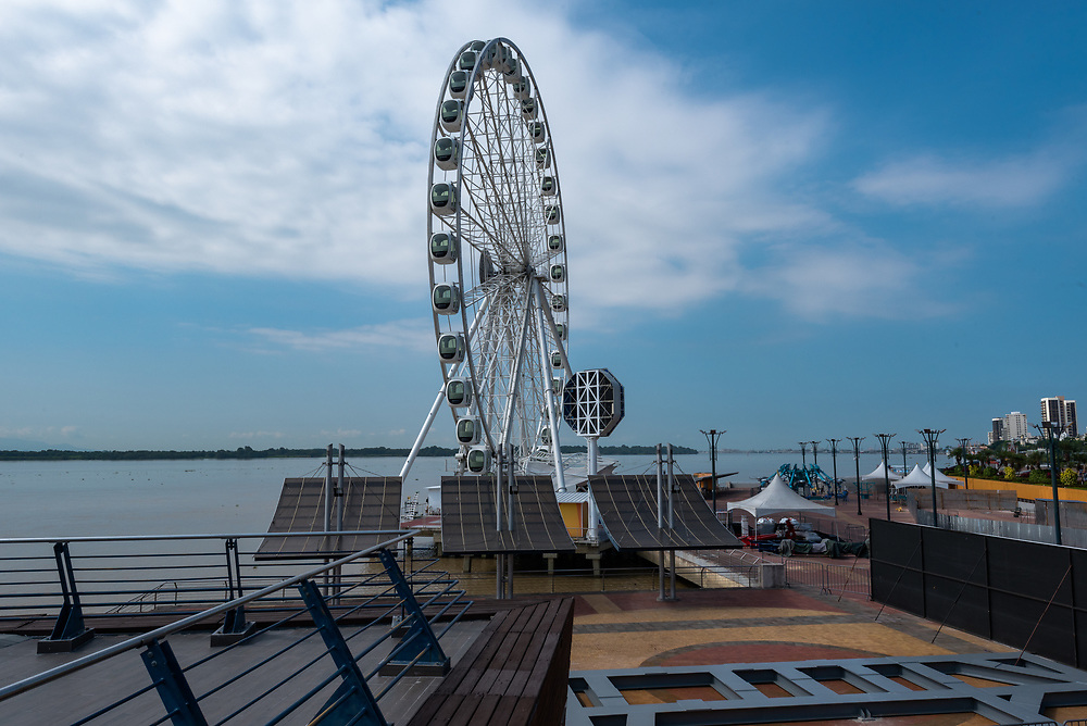 Guayaquil, Ecuador--April 15, 2018. A huge ferris wheel, known as La Perla, sits on the bank of the Guayas river in Guayaquil, Ecudaor. Editorial use only.