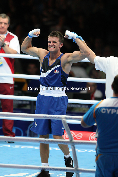 26.07.2014.  Glasgow, Scotland.  Glasgow Commonwealth Games.  Day 3.  Boxing Mens Middle Weight.  England's Antony Fowler defeats Kyriakos Spanos (CYP) for his place in the next round.