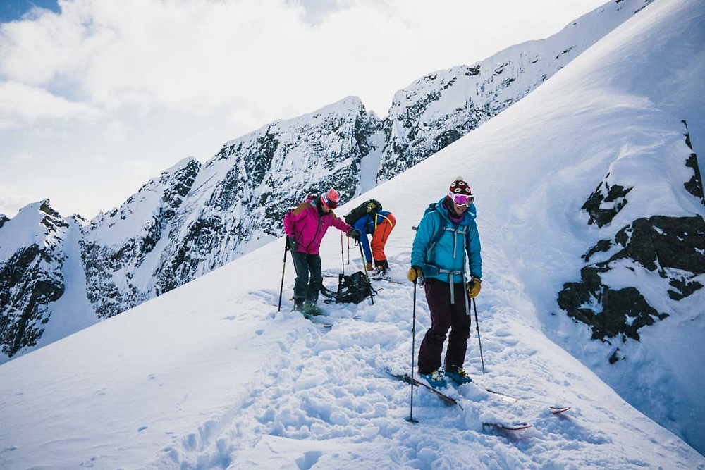 Late for Supper Transition. Emily Bodner, Erme Catino, and Joe Morabito get ready to drop into a couloir on Lakehead Peak, Howson Range, British Columbia.