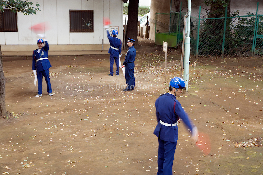 uniformed police practicing traffic sign instructions