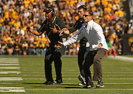 September 21 2013: Western Michigan Broncos head coach P. J. Fleck (right) is pumped up after a stop during the first quarter of the NCAA football game between the Western Michigan Broncos and the Iowa Hawkeyes at Kinnick Stadium in Iowa City, Iowa on September 21, 2013. Iowa defeated Western Michigan 59-3.
