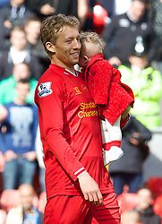 LIVERPOOL, ENGLAND - Sunday, May 11, 2014: Liverpool's Lucas Leiva with his daughter after the Premiership match at Anfield. (Pic by David Rawcliffe/Propaganda)
