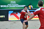 Wladimir Grbic of Serbia (L) passes the ball while exhibition match of Special Olympics Poland during Day 7 of the FIVB World Championships on July 7, 2013 in Stare Jablonki, Poland. <br /> <br /> Poland, Stare Jablonki, July 07, 2013<br /> <br /> Picture also available in RAW (NEF) or TIFF format on special request.<br /> <br /> For editorial use only. Any commercial or promotional use requires permission.<br /> <br /> Mandatory credit:<br /> Photo by &copy; Adam Nurkiewicz / Mediasport