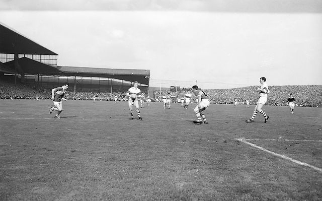 Kerry player runs outnumbered by Derry players during the All Ireland Minor Gaelic football final Derry v. Kerry in Croke park on the 26th September 1965.