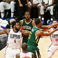 25 April 2017: Utah Jazz guard Rodney Hood (5) passes the ball over LA Clippers guard Austin Rivers (25) past LA Clippers center DeAndre Jordan (6) during the Utah Jazz 96-92 victory over the Los Angeles Clippers, during game 5 of the first round of the Western Conference playoffs, at the Staples Center, Los Angeles, California, USA.