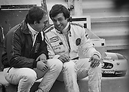 American Wolf-Ford F1 driver Bobby Rahal and France's Marlboro Lowenbrau McLaren-Ford driver Patrick Tambay share stories and advice during a lull in practice for the 1978 US Grand Prix at Watkins Glen, NY. <br />