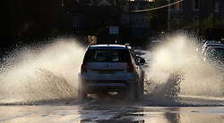 © Licensed to London News Pictures. 29/12/15<br /> York, UK. <br /> <br /> A car drives through the last few remaining puddles as flood water begins to subside on Huntington Road in York. Further rainfall is expected over coming days as Storm Frank approaches the east coast of the country.<br /> <br /> Photo credit : Ian Forsyth/LNP
