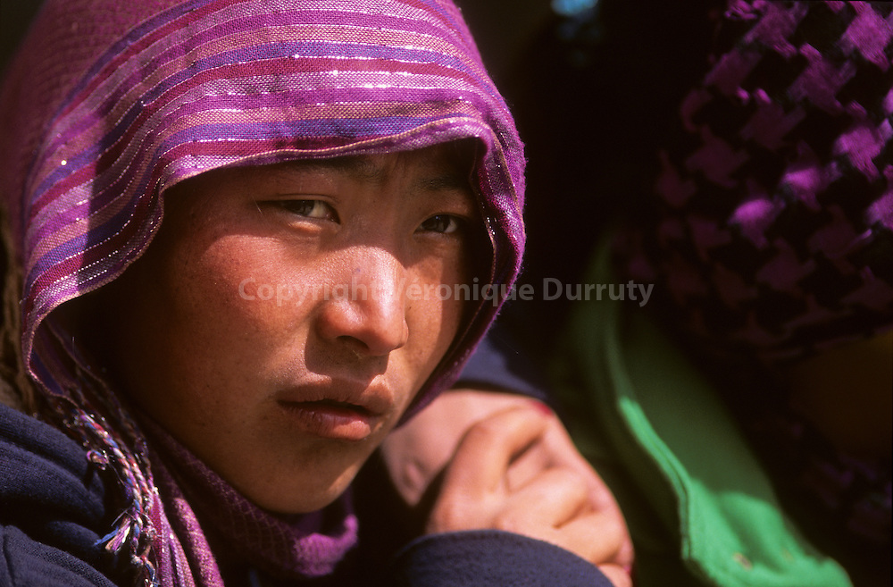 "In Lo Manthang, The capital with 1000 inhabitants. portrait of a Lo-Ba teenager // portrait d'adolescente Lo Ba à Lo Mantang, capitale du ""Royaume interdit "" . Mustang, Nepal"
